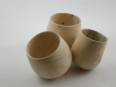 three wooden cups